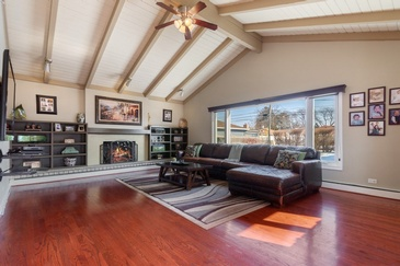 Living Room with Furniture and Lit Fireplace - Real Estate Photography Schaumburg by Visual Filmworks