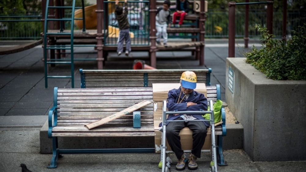 an-elderly-person-sits-on-a-bench-in-the-chinatown-neighborhood-of-san-francisco-california-u-s-on-tuesday-june-19-2018-the-labor-department-rule-aka-the-fiduciary-rule-conceived-by-the-obama-administration-was-me.jpg