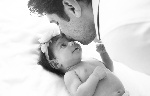 Father Kissing Baby - Newborn Photography session with Eve Parisa