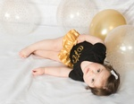 Adorable baby lying on bed with Balloons - Eve Parisa Photography
