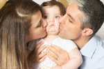 Parents Kissing Baby - Cake Smash Photography by Eve Parisa