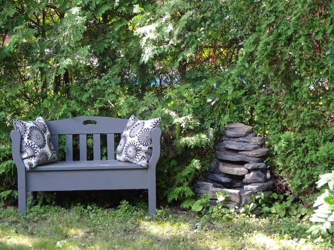 Wooden Bench in Garden - Assisted Living Residence Richmond Hill - Memory Lane Home Living Inc.