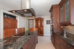 Transitional Kitchen with Wooden Cabinets by BEAULIEU DESIGN - Interior Design Firm Ottawa ON
