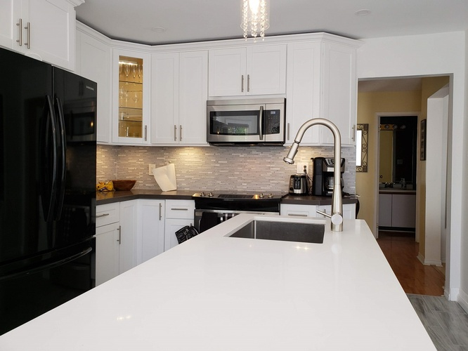 White Quartz Countertop and Cabinets - Kitchen Renovation Services Ajax by PCMINC