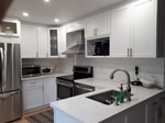 White Kitchen with Cabinets - Residential Renovation Uxbridge by PCM Inc.
