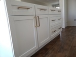 Gold Handle Kitchen Cabinet with Vinyl Flooring - Residential Renovation Baltimore by PCM Inc.