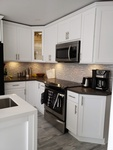 Fully Equipped Kitchen - Modern Residential Renovation Bowmanville by PCM Inc.