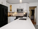 White Quartz Countertop and Cabinets -  Kitchen Renovation Ajax by PCM Inc.