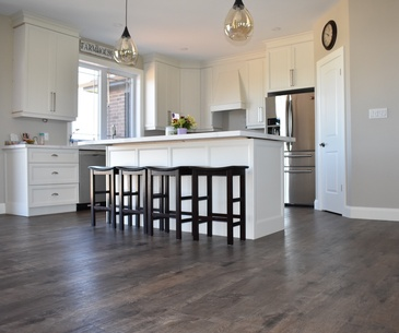 Farmhouse Kitchen Laminate Flooring Smithville by Bert Vis Flooring Inc.