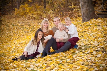 Happy Family in Autumn Garden captured by Professional Photographer Edmonton - Artistic Creations Photography and Video
