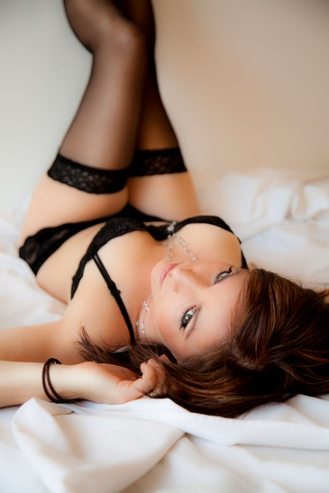 Young lady on Lying on Bed in Boudoir Outfit - Boudoir Photography Edmonton by Artistic Creations Photography and Video