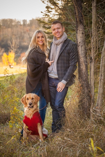 Couple standing with a Dog - Photography Services Edmonton by Artistic Creations Photography and Video