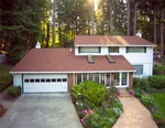 Beautiful House with a Garden - Residential Roofing Redmond by Bellevue Roofing Company, Inc