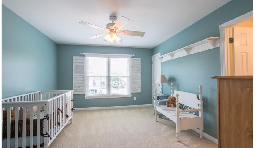 Kids Room with a Chandelier Fan and a Sofa -Interior Decorator Athens at Sage Key Interiors
