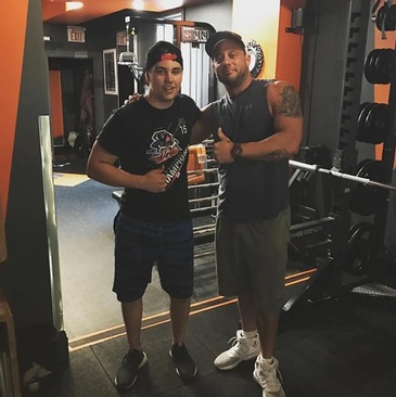 Young Man with Burlington Personal Trainer at Bar None Fitness Studio