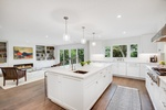 Bright White Kitchen by PB Construction - Custom Home Builder Austin