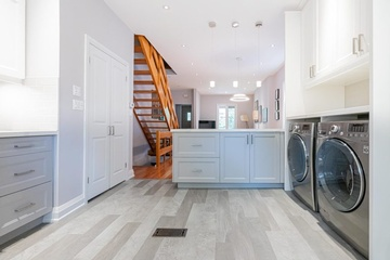 Laundry Room with White Cabinets - Interior Design Cambridge by Lenore Brooks Design