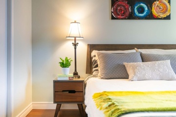 A Table Lamp besides the Bed - Interior Decoration Waterloo by Lenore Brooks Design