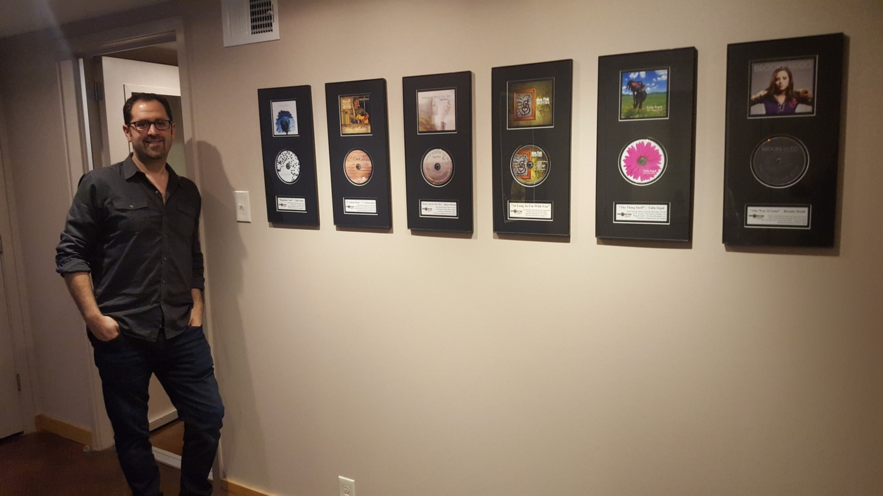 Dave Mallen posing next to the Award Winning Songs in Music Best Recording Studio Northern VA
