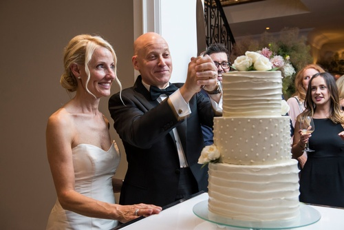Bride and Groom Cutting the Wedding Cake - Luxury Wedding Photography Toronto ON