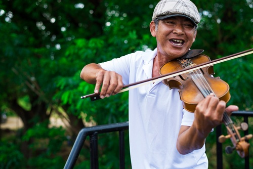 Aged man playing a Violin - Travel Photography Services Burlington by Matt Tibbo