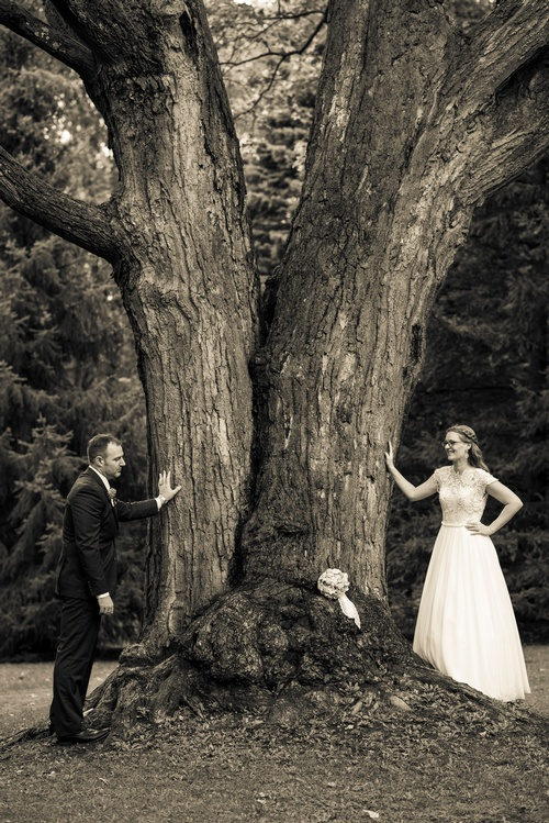 Bride and Groom Standing near a Tree Captured by Luxury Wedding Photographer Vaughan - Matt Tibbo