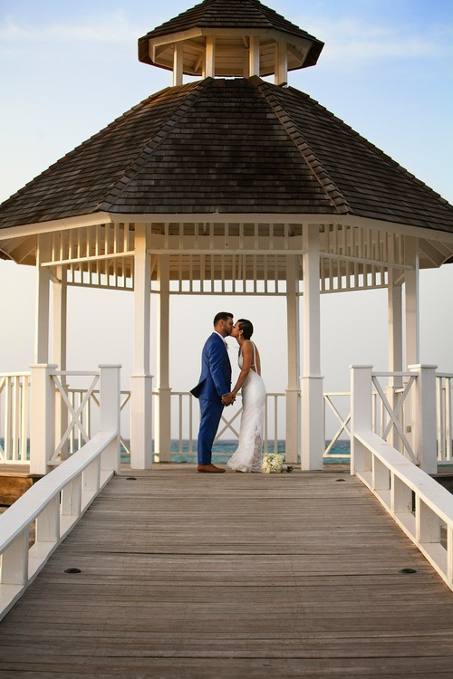 Bride and Groom Kissing under a Gazebo Captured by Luxury Wedding Photographer Hamilton