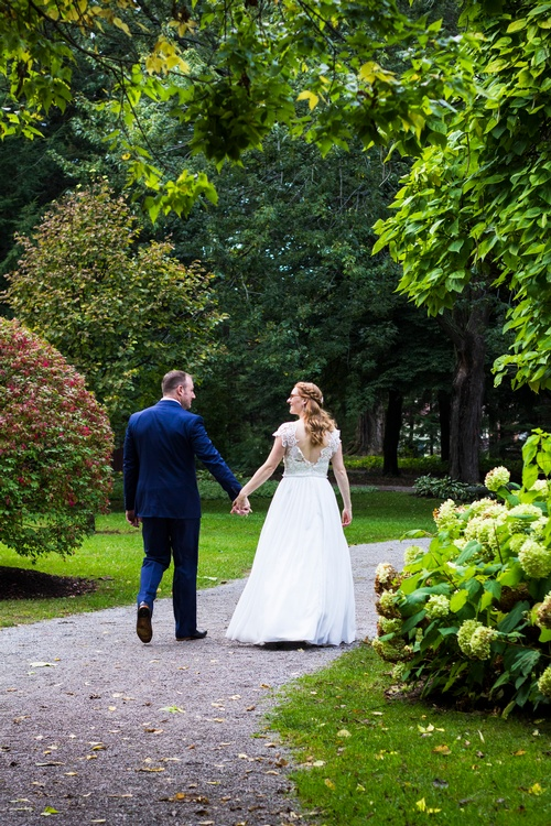 Newly Wed Couple Walking in a Park Captured by Matt Tibbo - Luxury Wedding Photographer Oakville