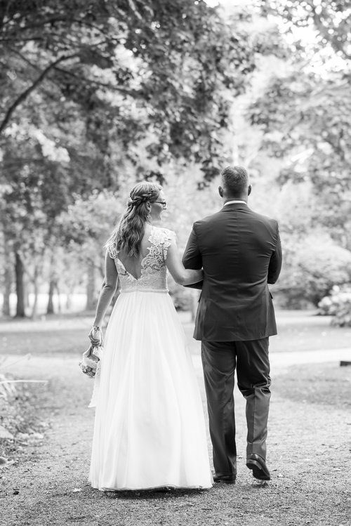 Bride and Groom Walking in the Woods Captured by Matt Tibbo - Luxury Wedding Photographer Markham
