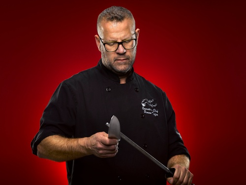 Professional Cook Holding Knives Captured by Matt Tibbo - Editorial Photography Burlington
