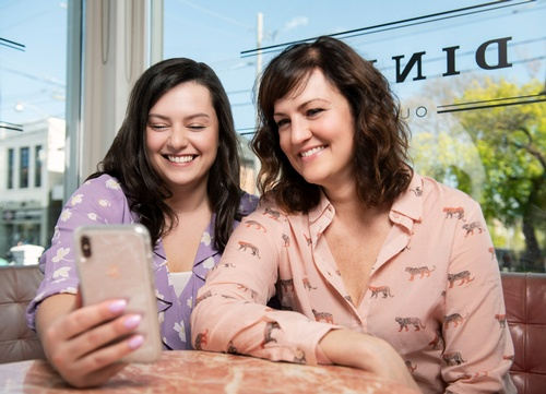Women clicking selfie - Business Photography Toronto by Matt Tibbo