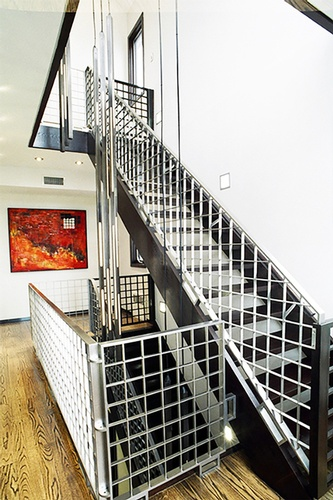 Brushed 3-story stainless steel staircase - Interior Design Services Brooklyn by DDG Design Studio Inc