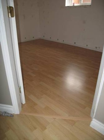 Laminate Flooring Installation Services Coquitlam by Best Handy Hubby Renovation and Painting Services