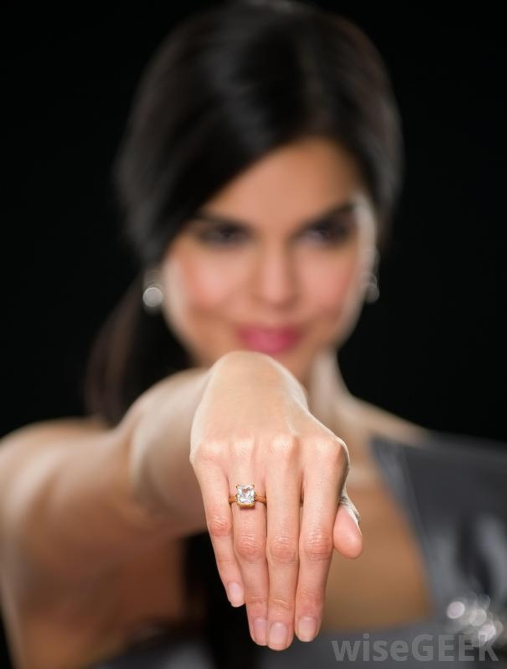 woman-with-diamond-ring-on-hand.jpg