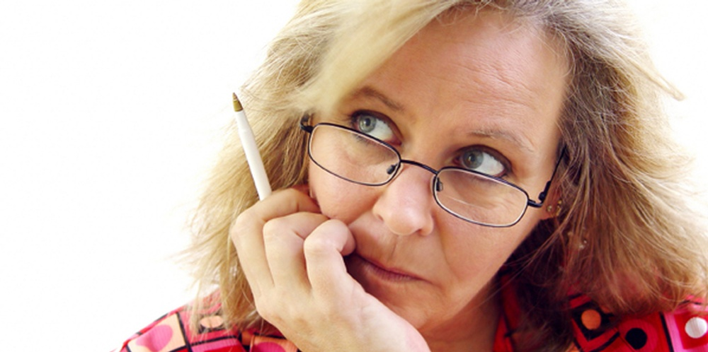 boomer-woman-thinking-with-pen-598-x-298.jpg