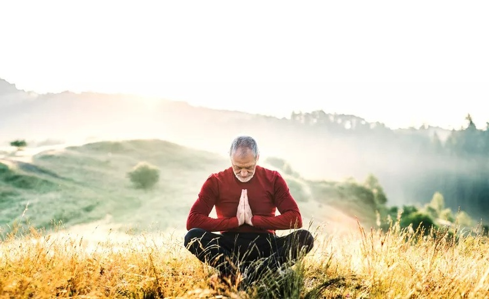 senior-man-meditating-outdoors-i.jpg