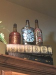 Hand painted glass bottles stacked on stacked books - Fort Worth Interior Decoration by Valentine Interior Design