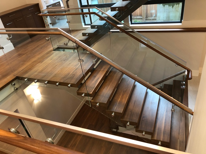 Floating Wooden Staircase by Flooring Contractor Vancouver at TJL Floor And Garage Door Inc