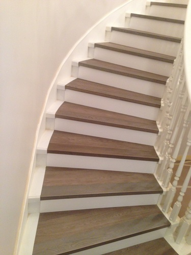 Curved Wooden Staircase by TJL Floor And Garage Door Inc - Richmond Flooring Store