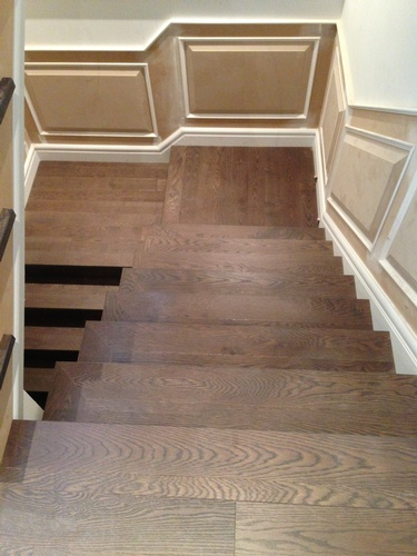 Modern Wooden Stairs by TJL Floor And Garage Door Inc - Floor Installation Richmond