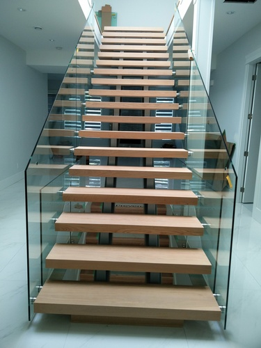 Staircase with Tempered Glass by TJL Floor And Garage Door Inc - Flooring Contractor Vancouver