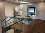 Wooden Staircase and Railing by TJL Floor And Garage Door Inc - Flooring Contractor Burnaby