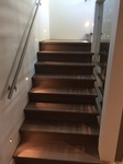 Wooden Staircase with Wall Mounted Handrails by TJL Floor And Garage Door Inc - Flooring Contractor Coquitlam