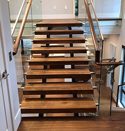 Modern Laminated Stairs by Flooring Contractor Richmond at TJL Floor And Garage Door Inc