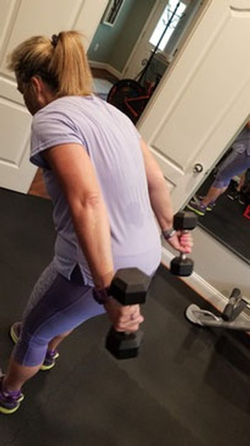 Woman with dumbbells - One On One Personal Training Maryland by Home Core Fitness