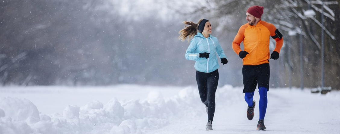 Couple jogging in the snow - Smart Digital Weight Scale by Trackit INC