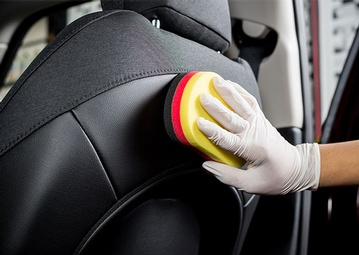 stock-photo-car-detailing-series-cleaning-car-seat-411742066